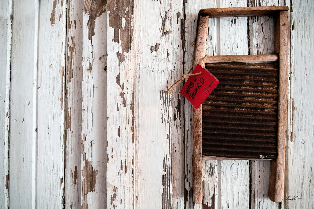 rusty washboard on a wall