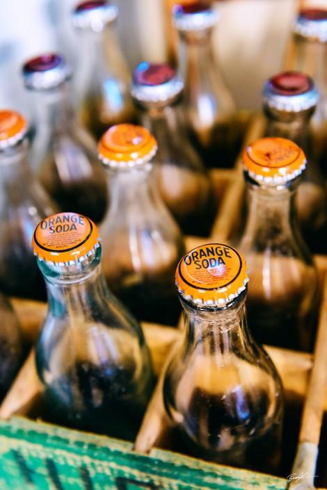 Orange Soda Bottles and Crate
