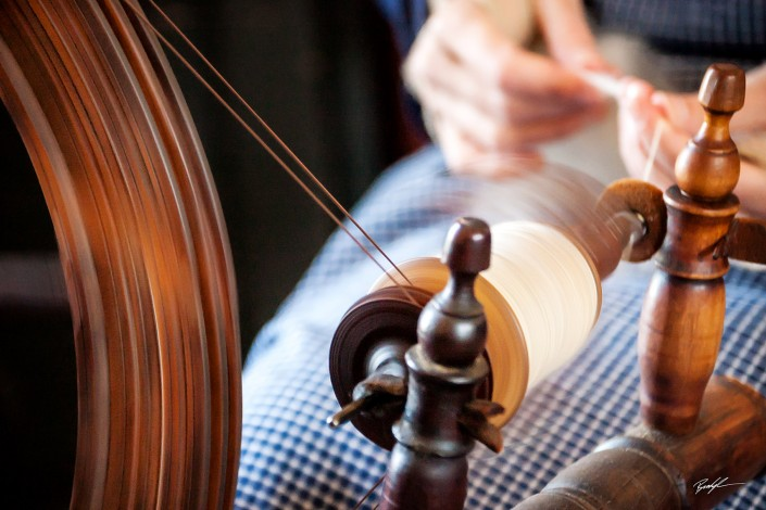 Spinning Wheel and Woman's Hands