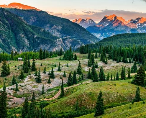 San Juan Mountains Alpenglow and Cabin Colorado